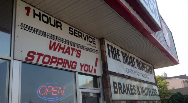 Brake Check store front signs